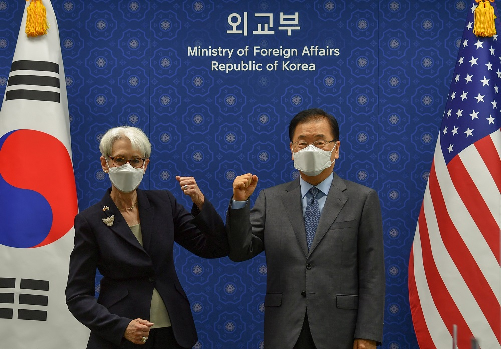 US Deputy Secretary of State, Wendy Sherman and South Korean Foreign Minister Chung Eui-yong elbow bump prior to their meeting at the foreign ministry in Seoul, South Korea, July 22, 2021. ― Pool via Reuters