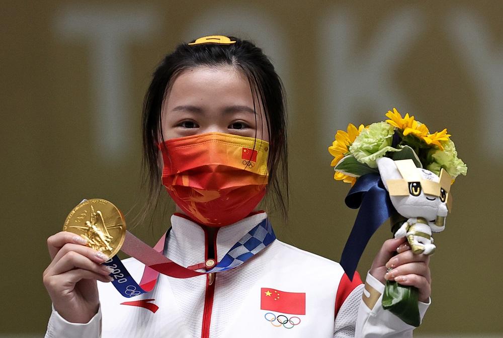 Gold medallist Yang Qian of China celebrates on the podium at the Asaka Shooting Range in Tokyo July 24, 2021. ― Reuters pic