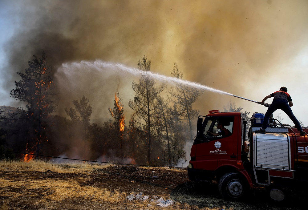 A firefighter tries to extinguish a wildfire near Marmaris, Turkey August 1, 2021. —  REUTERS pic