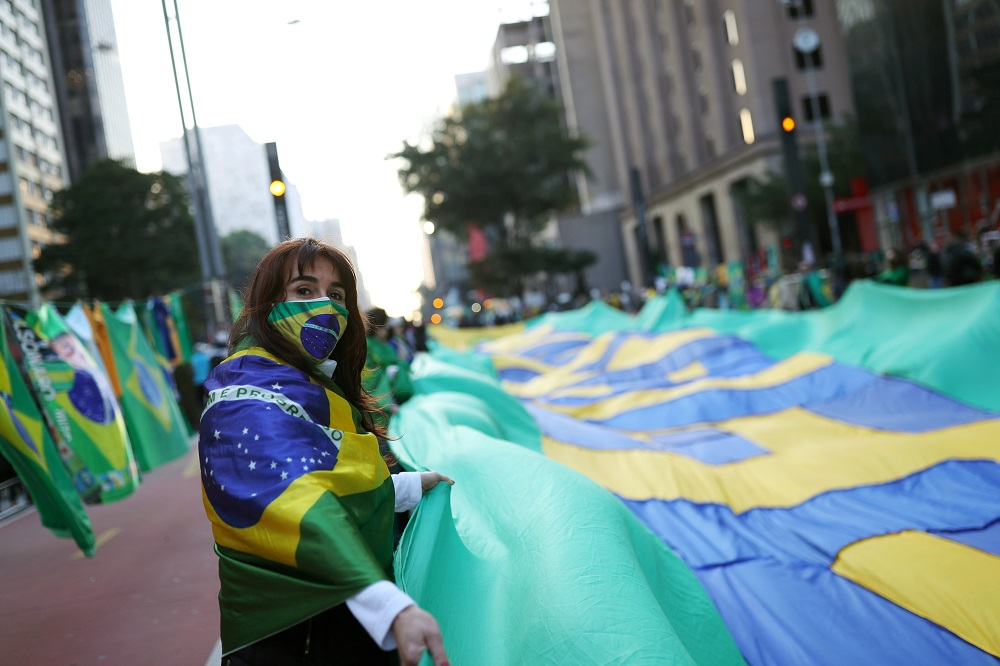 A supporter of Brazilian President Jair Bolsonaro wears a face mask as she takes part in a protest calling for a printed vote, in Paulista Avenue, Sao Paulo August 1, 2021.  — Reuters pic