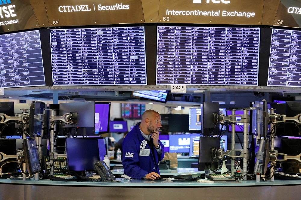A trader works on the trading floor of the New York Stock Exchange in Manhattan, New York August 17, 2021. — Reuters pic