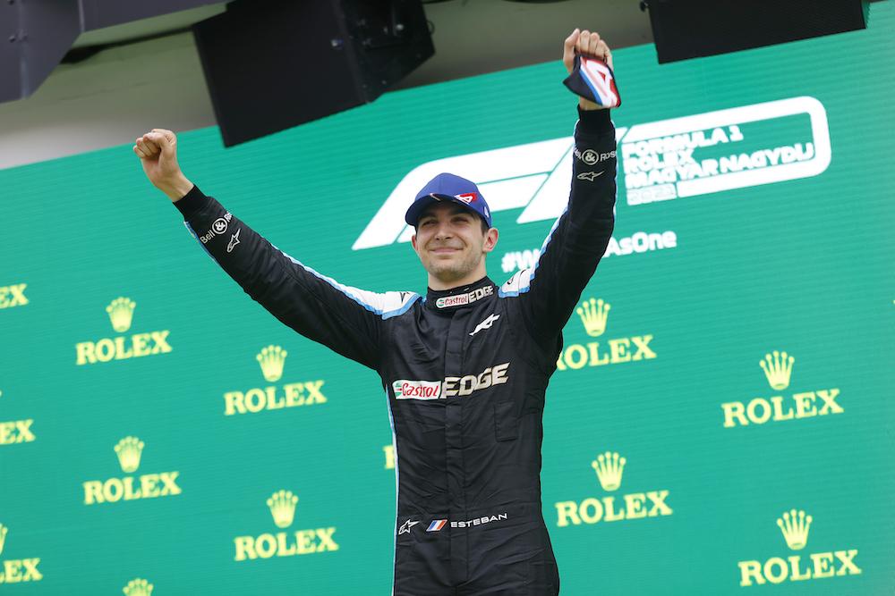 Alpine's Esteban Ocon celebrates on the podium after winning the Hungarian Grand Prix at Hungaroring, Budapest, Hungary August 1, 2021. — Pool via Reuters pic