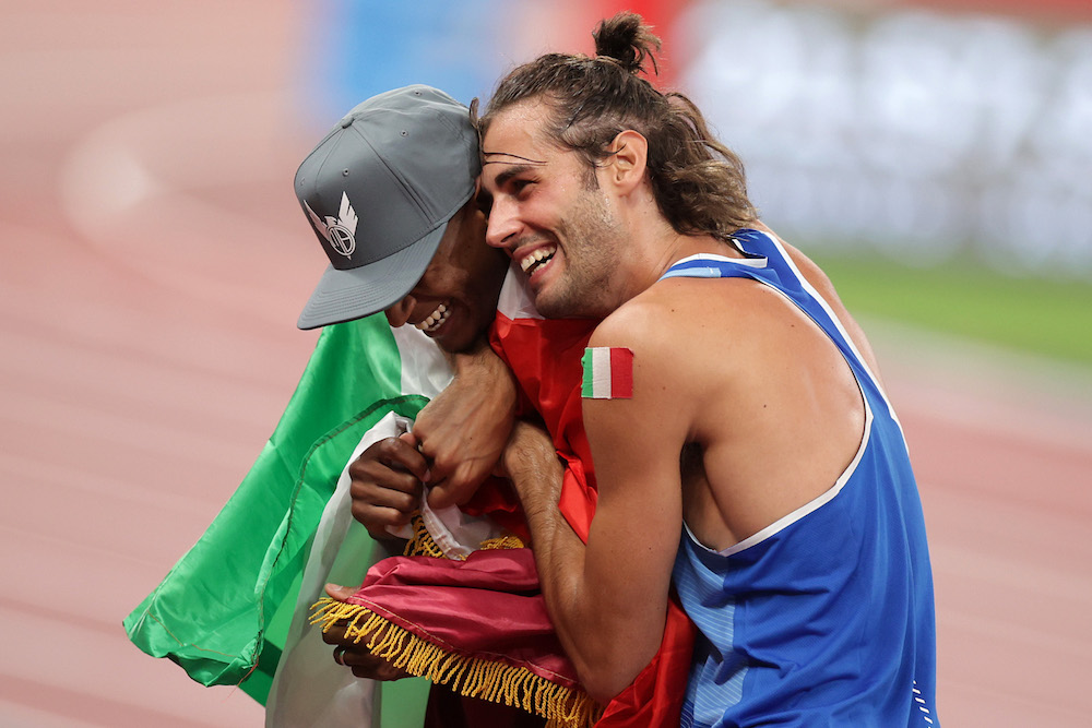 Mutaz Essa Barshim of Qatar and Gianmarco Tamberi of Italy celebrate after winning gold at the Olympic Stadium, Tokyo, Japan August 1, 2021. — Reuters pic