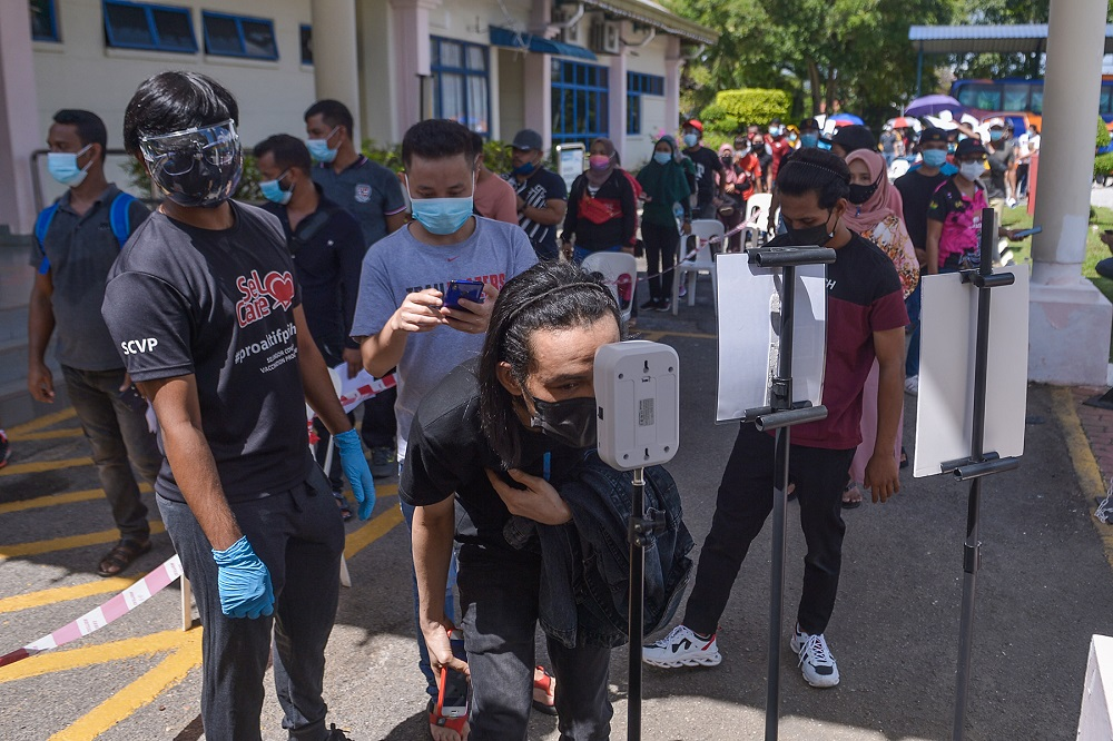 Penang opened walk-in vaccination for foreign workers at four designated PPVs on September 17. — Picture by Miera Zulyana
