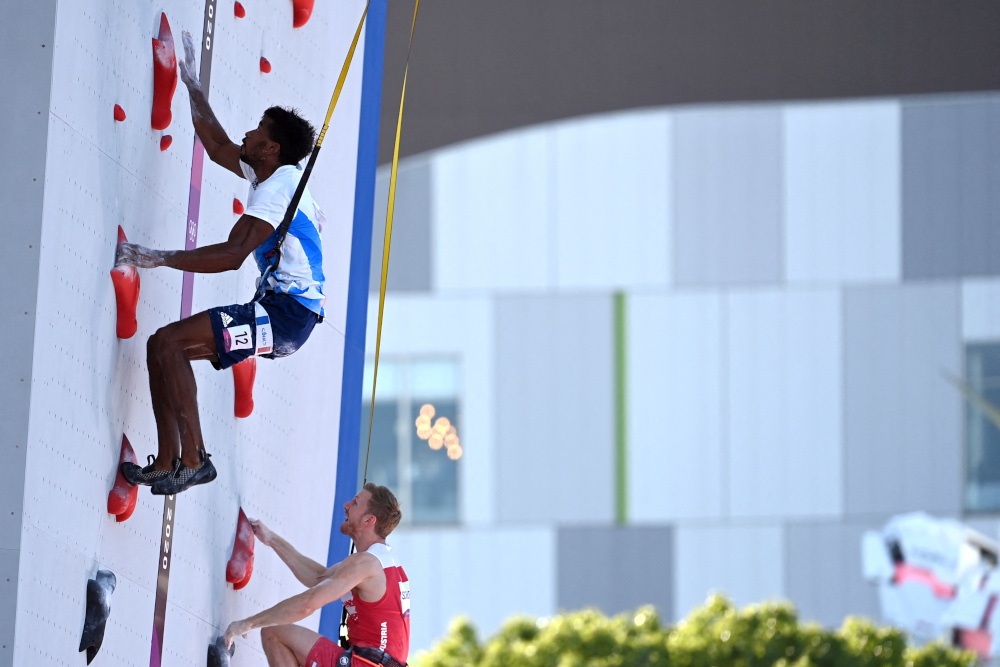 France's Bassa Mawem (top) competes with Austria's Jakob Schubert in the men's sport climbing speed qualification during the Tokyo 2020 Olympic Games at the Aomi Urban Sports Park in Tokyo August 3, 2021. ― AFP pic