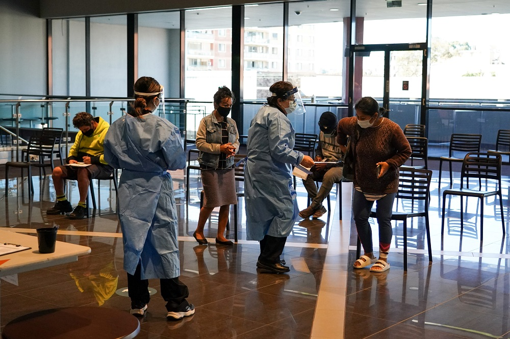 Medical staff assist members of the public in the waiting area of a Covid-19 vaccination clinic at the Bankstown Sports Club as the city experiences an extended lockdown, in Sydney, Australia August 3, 2021. ― Reuters pic