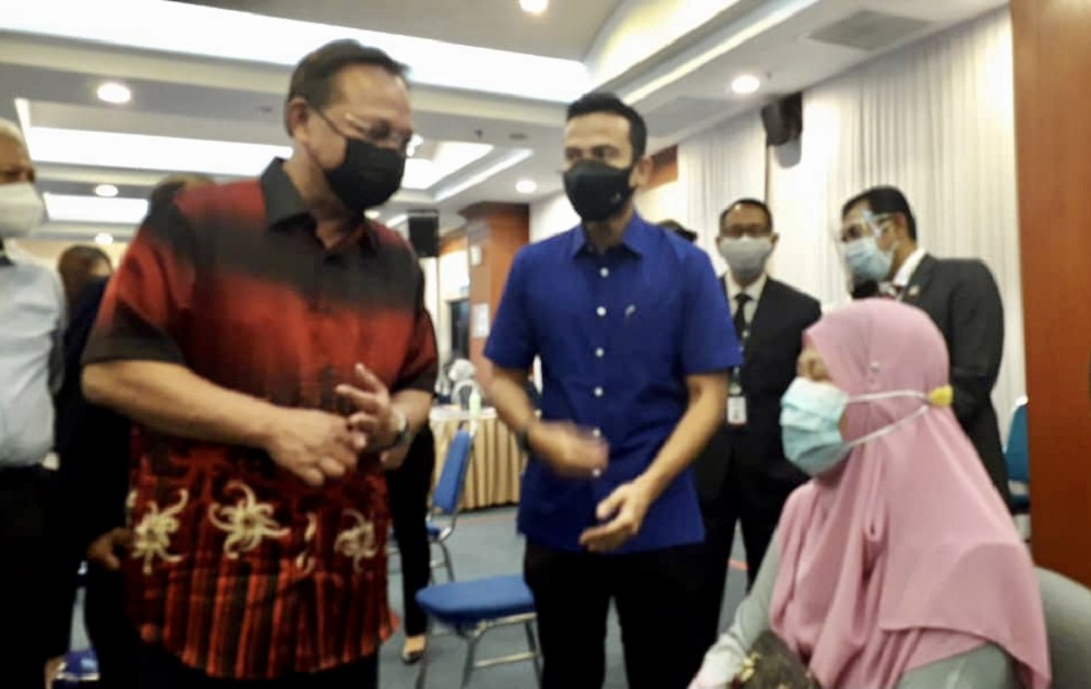 Johor Mentri Besar Datuk Hasni Mohammad (left) at the Vaccination Centre (PPV) at KPJ Abdul Samad Hospital in Johor Baru August 6, 2021 — Picture by Ben Tan