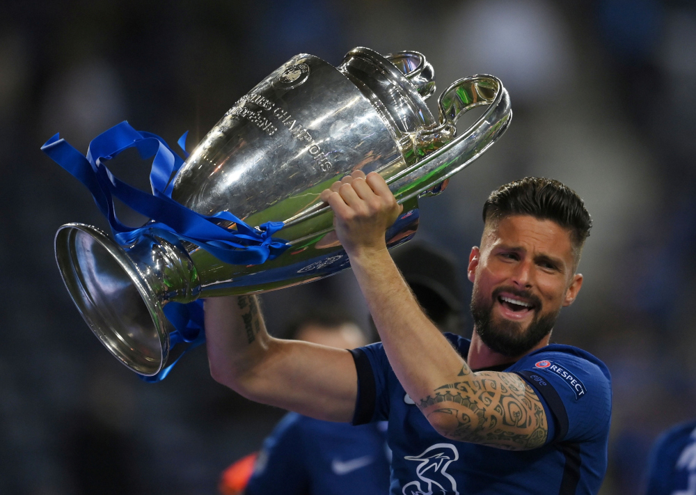 Chelsea's Olivier Giroud celebrates with the trophy after winning the Champions League at the Estadio do Dragao in Porto, Portugal, May 29, 2021. ― Reuters pic