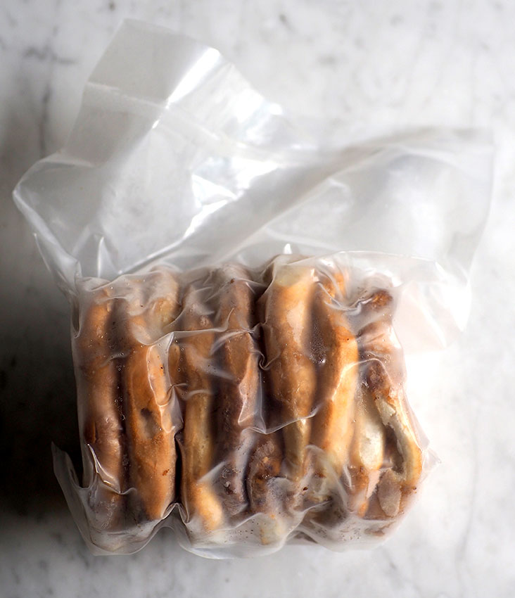 The frozen 'gong pia' is vacuum packed and can be heated up in an oven to its crackly goodness