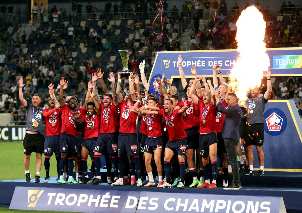 Lille players celebrate winning the Trophee des Champions after beating PSG at the Bloomfield Stadium, Tel Aviv August 1, 2021. — Reuters pic