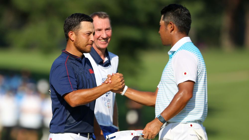 Hideki Matsuyama of Japan congratulates Xander Schauffele (left) of the United States after the latter won the golf men's individual gold medal at the Kasumigaseki Country Club, Saitama August 1, 2021. — Reuters pic