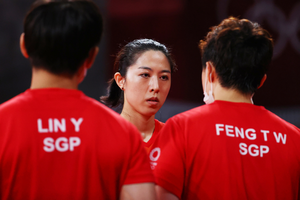Yu Mengyu of Singapore with Lin Ye of Singapore and Feng Tianwei of Singapore during her match against Jia Nan Yuan of France, at the Tokyo Metropolitan Gymnasium, August 2, 2021. ― Reuters pic