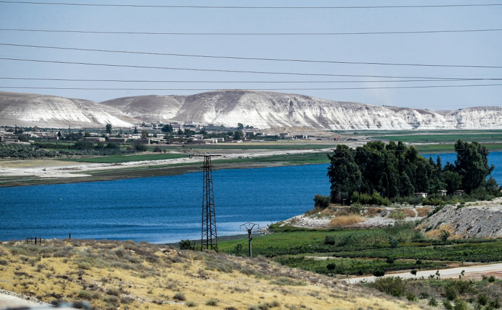 This picture taken on July 24, 2021 shows a view of the high voltage electricity transmission lines connecting to the 1999 Tishrin (October) Dam (unseen) along the Euphrates river near Manbij in eastern Syria. — AFP pic