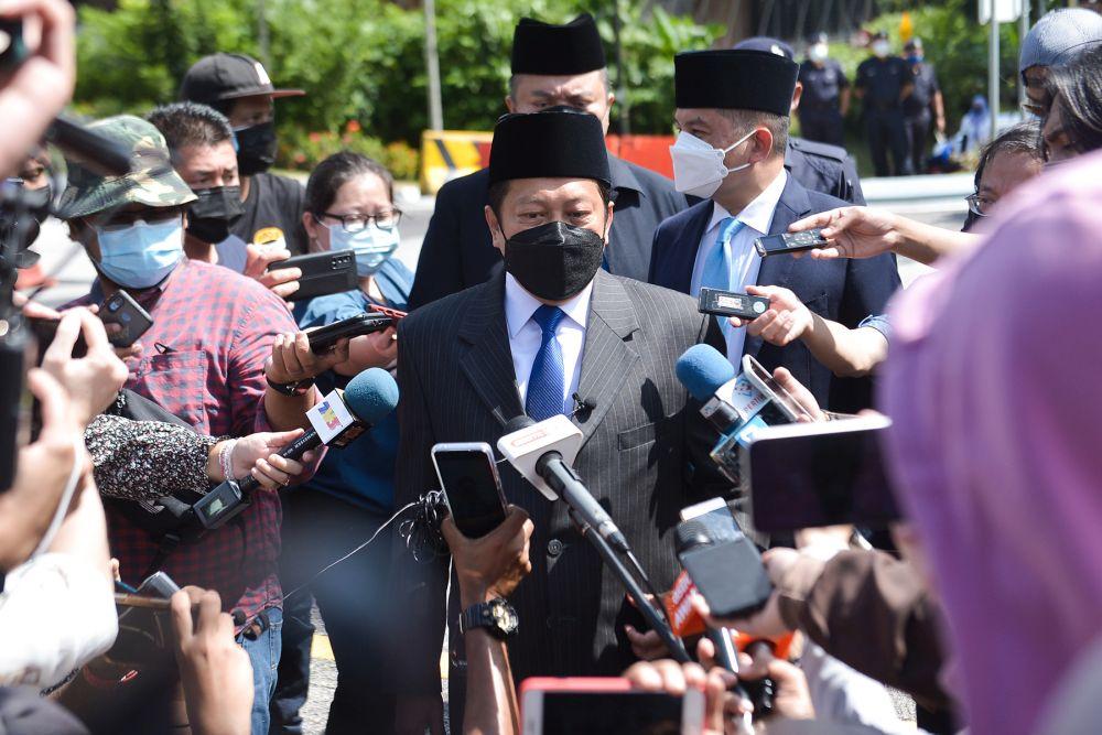 Umno secretary-general Datuk Seri Ahmad Maslan speaks to reporters before leaving Istana Negara in Kuala Lumpur August 19, 2021. — Picture by Miera Zulyana