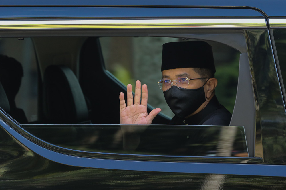 International Trade and Industry Minister Datuk Seri Mohamed Azmin Ali waves as he leaves Istana Negara after taking his oath of office, loyalty and secrecy in Kuala Lumpur August 30, 2021. — Picture by Yusof Mat Isa
