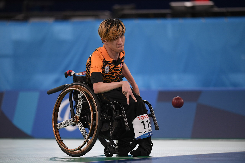 Malaysia's paralympic Boccia athlete Chew Wei Lun competes against South Korean Jung Sungjoon in the BC1 Category Boccia at the Tokyo 2020 Paralympic Games at Ariake Gym August 29, 2021. — Bernama pic