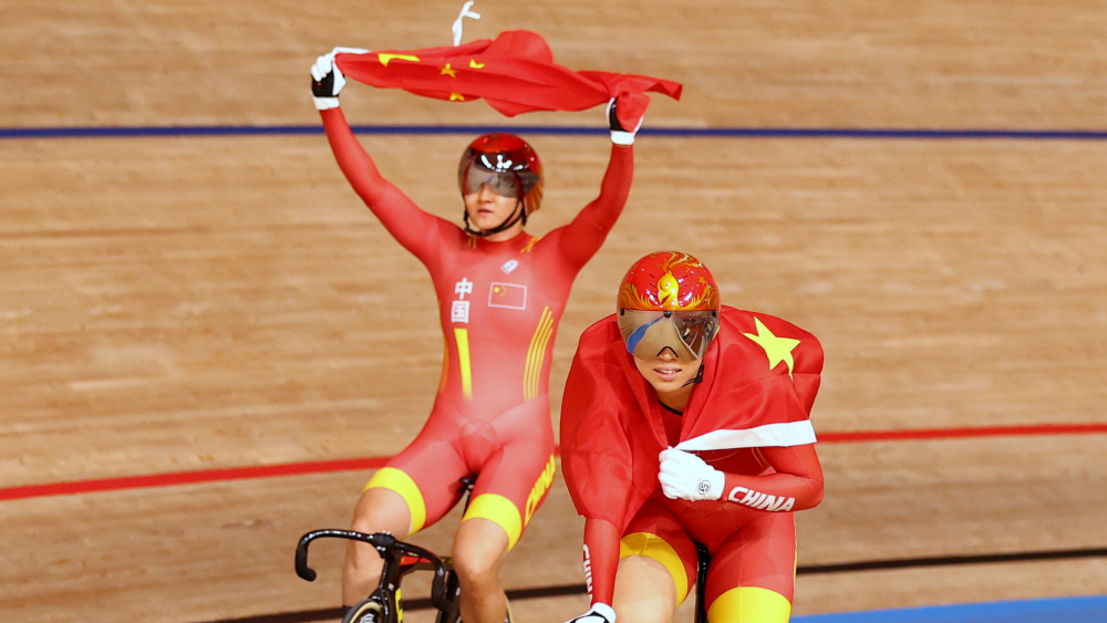 Bao Shanju of China and Zhong Tianshi of China celebrate winning the race and the gold medal for the women's team sprint at Izu Velodrome, Shizuoka, August 2, 2021. ― Reuters pic