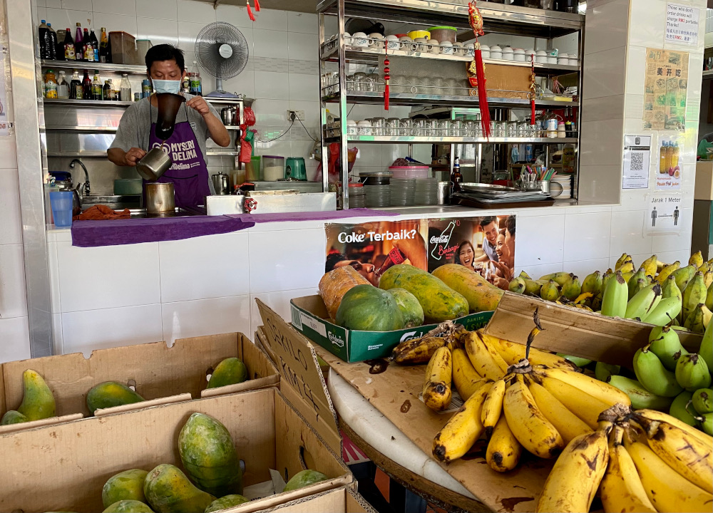 Island Park cafe owner Tan has taken to selling fruits and vegetables to supplement his income. ― Picture by Steven Ooi KE