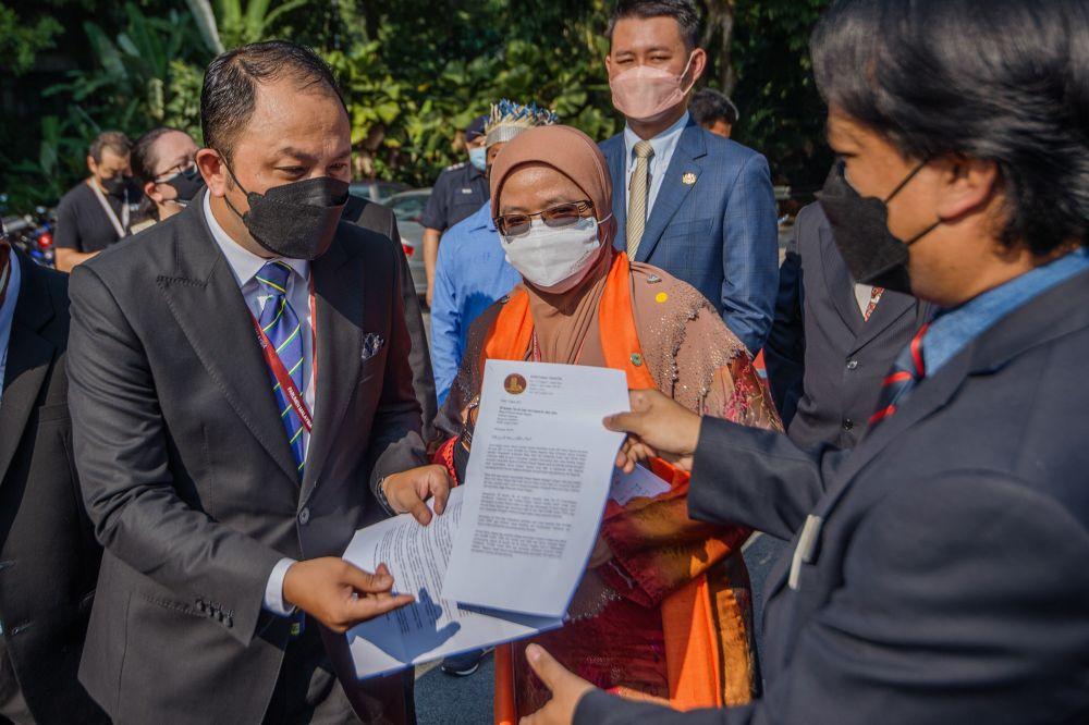 Senator Mohd Yusmadi Mohd Yusoff hands over the letter to Dewan Negara secretary Muhd Sujairi Abdullah on August 3, 2021. ― Picture by Shafwan Zaidon