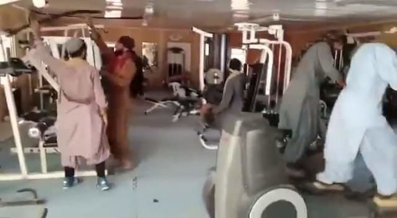 Taliban soldiers filmed each other while exploring gym equipment in Afghanistan. — Screengrab from TRT World Facebook