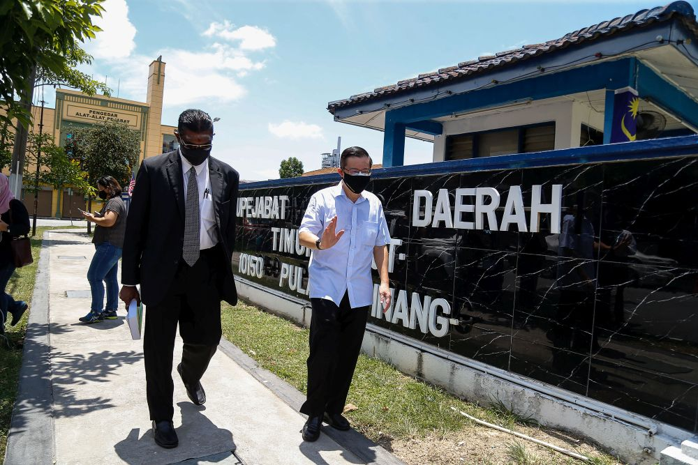 Bagan MP Lim Guan Eng is seen with Jelutong MP RSN Rayer at the Northeast district police station in George Town August 11, 2021. ― Picture by Sayuti Zainudin