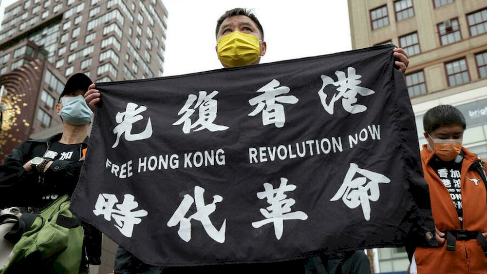President Joe Biden's decision allows Hong Kong residents currently in the United States, such as these Hong Kongers protesting for democracy in New York in June 2021, to remain in the country for 18 months and to be allowed to work. — Getty Images North America/AFP pic