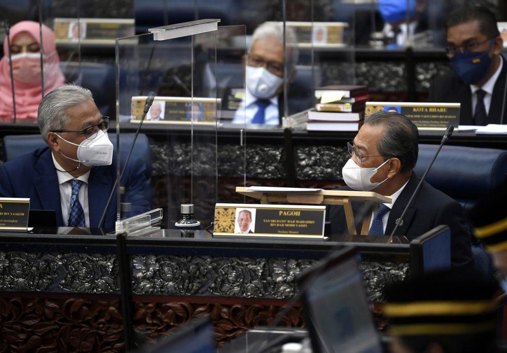 Prime Minister Tan Sri Muhyiddin Yassin is seen talking to Deputy Prime Minister Datuk Seri Ismail Sabri Yaakob during a special Parliament sitting in Kuala Lumpur July 26, 2021. — Bernama pic