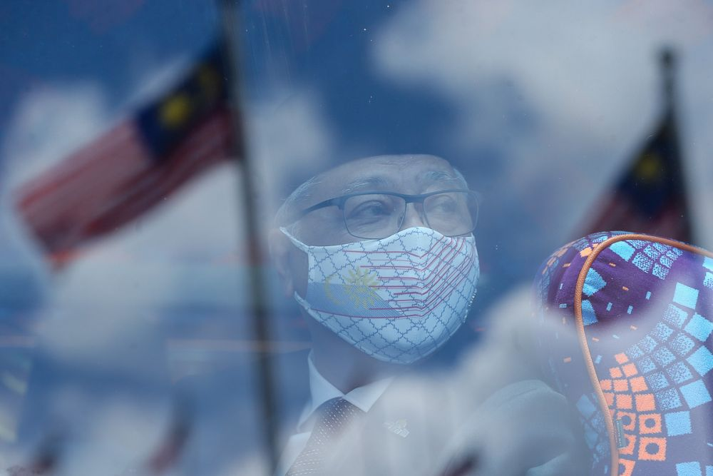Datuk Seri Ismail Sabri Yaakob is seen on a bus ahead of his audience with the Yang di-Pertuan Agong at Istana Negara in Kuala Lumpur August 19, 2021. — Picture by Yusof Mat Isa