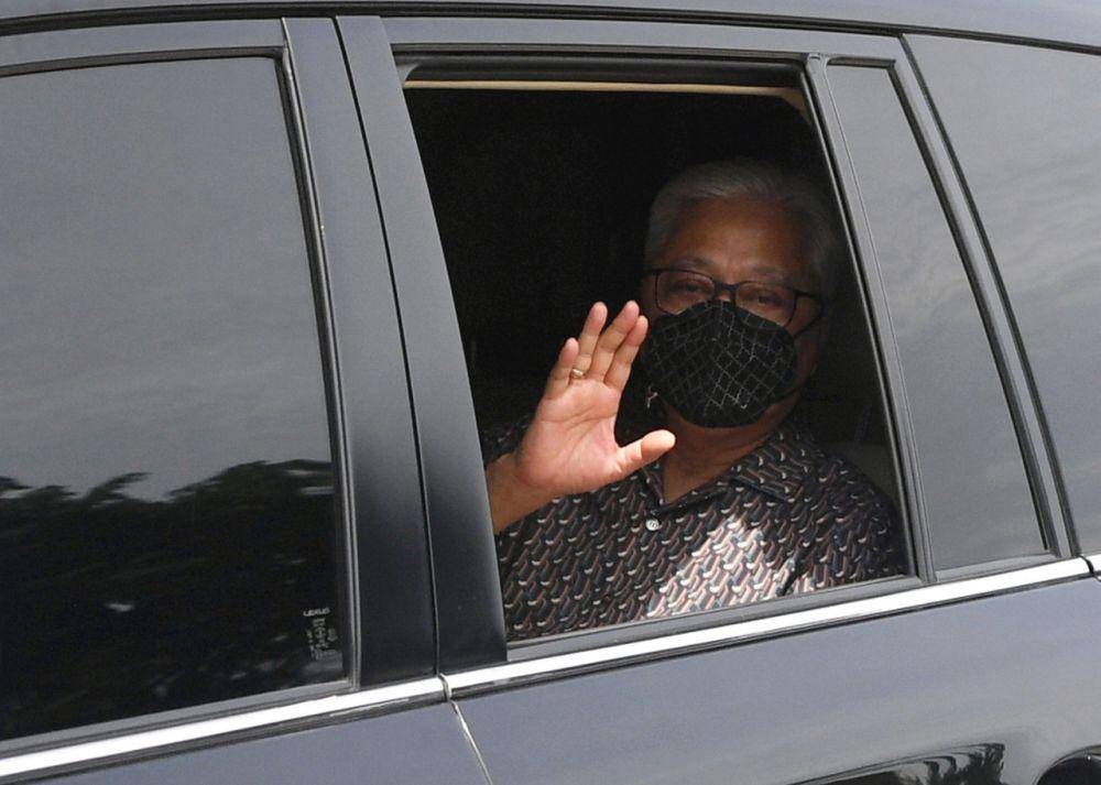 Deputy Prime Minister Datuk Seri Ismail Sabri Yaakob waves at reporters as he leaves Kampung Mengkarak, Bera August 1, 2021. — Bernama pic