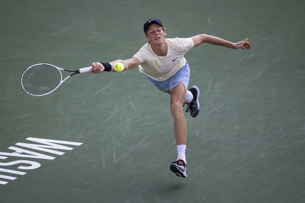 Jannik Sinner stretches for a forehand against Mackenzie McDonald during the singles final match at Citi Open at Rock Creek Park Tennis Centre, Washington August 8, 2021. — Reuters pic