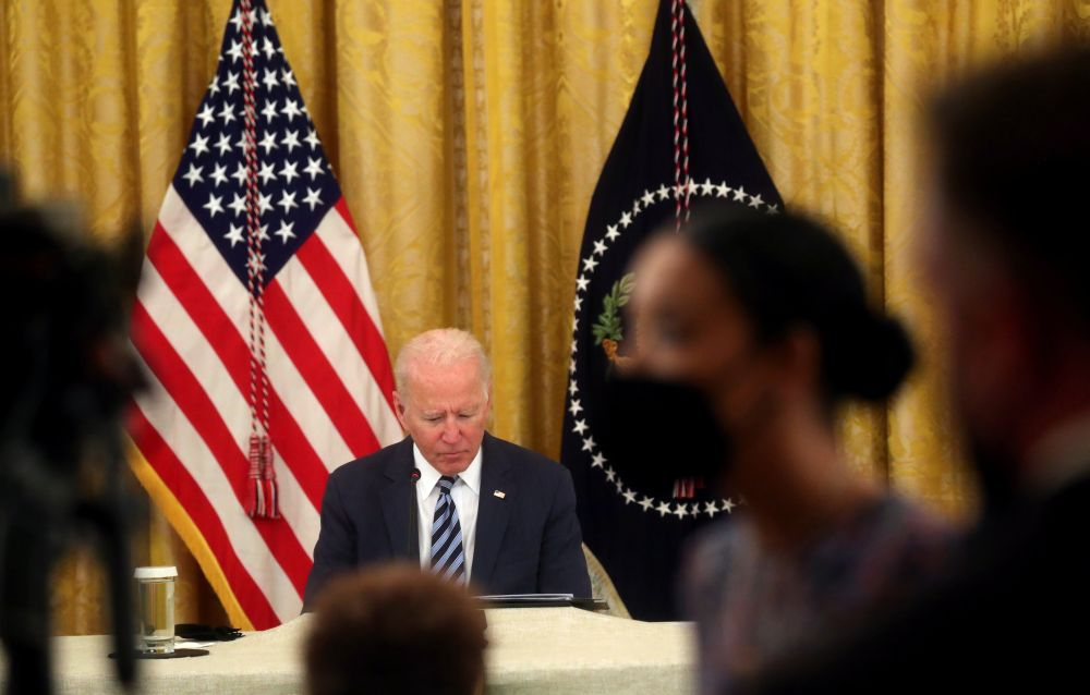 US President Joe Biden discusses how to improve the nation's cybersecurity with private sector leaders in the East Room at the White House in Washington August 25, 2021. — Reuters pic