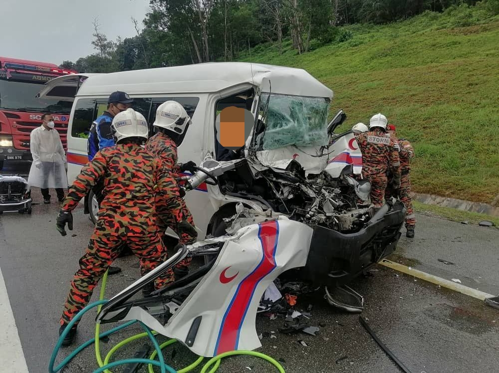 Firemen extracting the victims from a Health Ministry ambulance after it was involved in an accident along Kilometre 9.7 of the North-South Expressway near Johor Baru, August 18, 2021 — Picture courtesy of the Johor Fire and Rescue Department