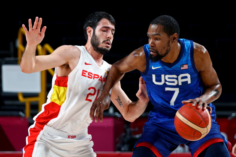 Kevin Durant of the United States in action with Alex Abrines of Spain at the Saitama Super Arena, Saitama, August 3, 2021. ― Reuters pic