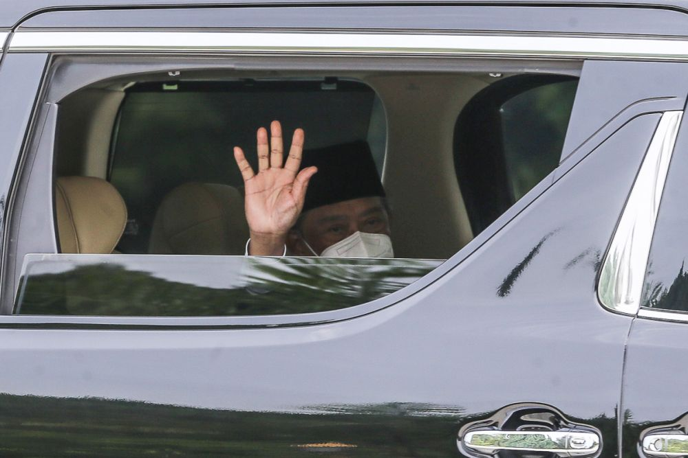 Prime Minister Tan Sri Muhyiddin Yassin waves at reporters as he leaves Istana Negara following an audience with the Yang di-Pertuan Agong in Kuala Lumpur August 4, 2021. — Picture by Yusof Mat Isa