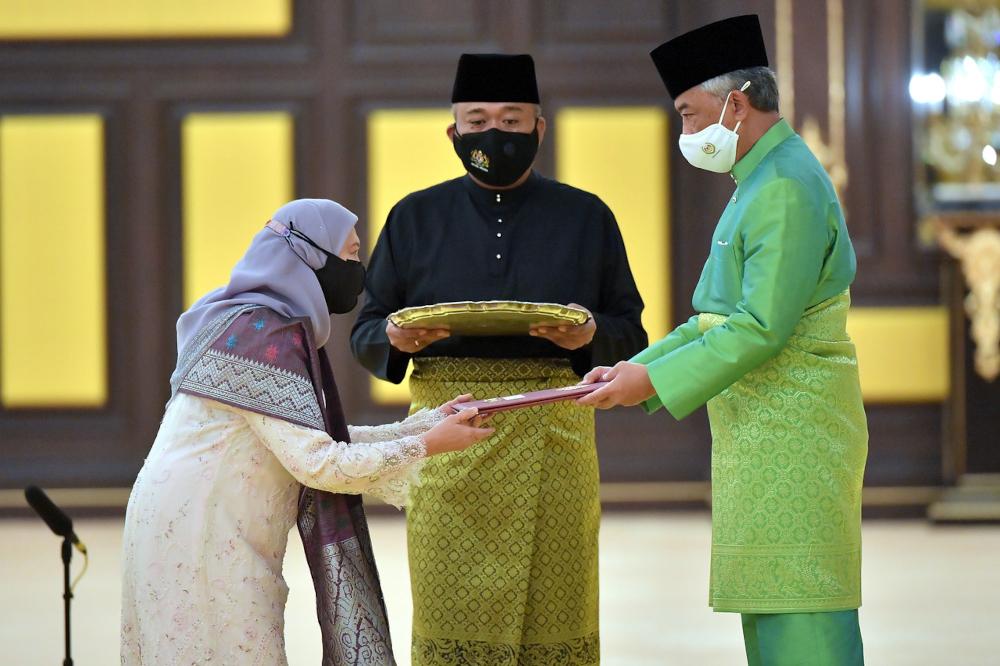 The Yang di-Pertuan Agong presents the appointment letter to Tourism, Arts and Culture Minister Datuk Seri Nancy Shukri at Istana Negara, August 30, 2021. — Bernama pic
