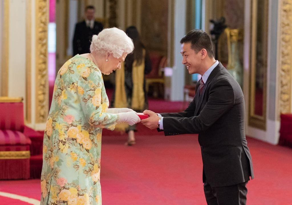 Matt Oon (right) meeting Queen Elizabeth II when he received the Queen's Young Leader's Award in 2018. — Photo by Matt Oon