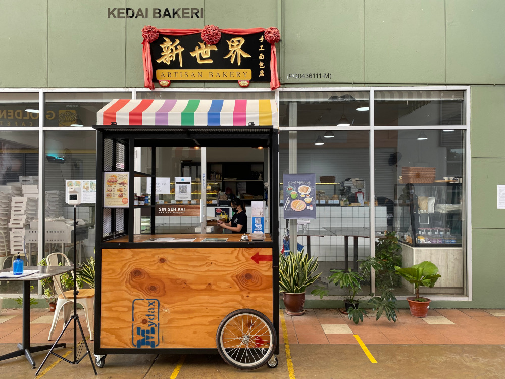Sin Seh Kai Artisan bakery cafe blocking their entrance as they are not open for dine in at the moment. ― Picture by Steven Ooi KE