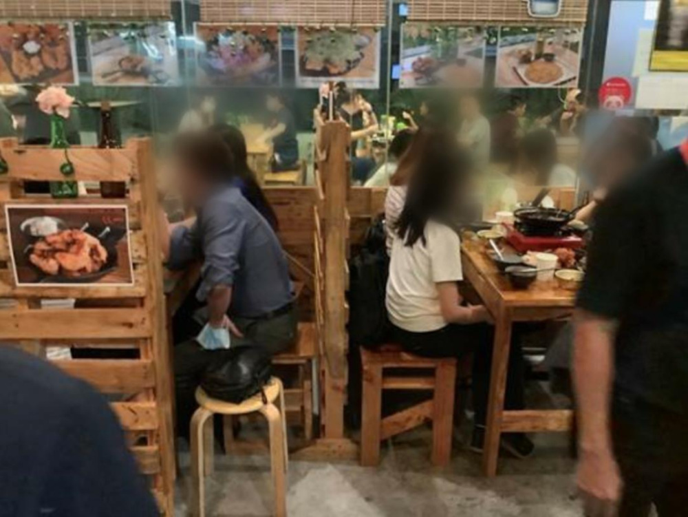 Ahtti, an eatery in Jurong East, failed to ensure safe distancing of at least 1m between groups of customers on many occasions. — Picture by Singapore Food Agency