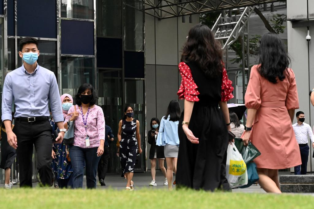 Singapore allows up to half of the people who can work from home to return to their workplaces from today. — AFP file pic