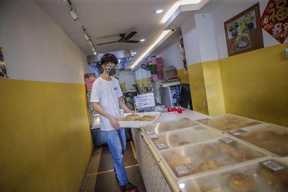 Sim Ming Zhen is seen at work at a bakery in Taman Desa, Kuala Lumpur August 11, 2021.