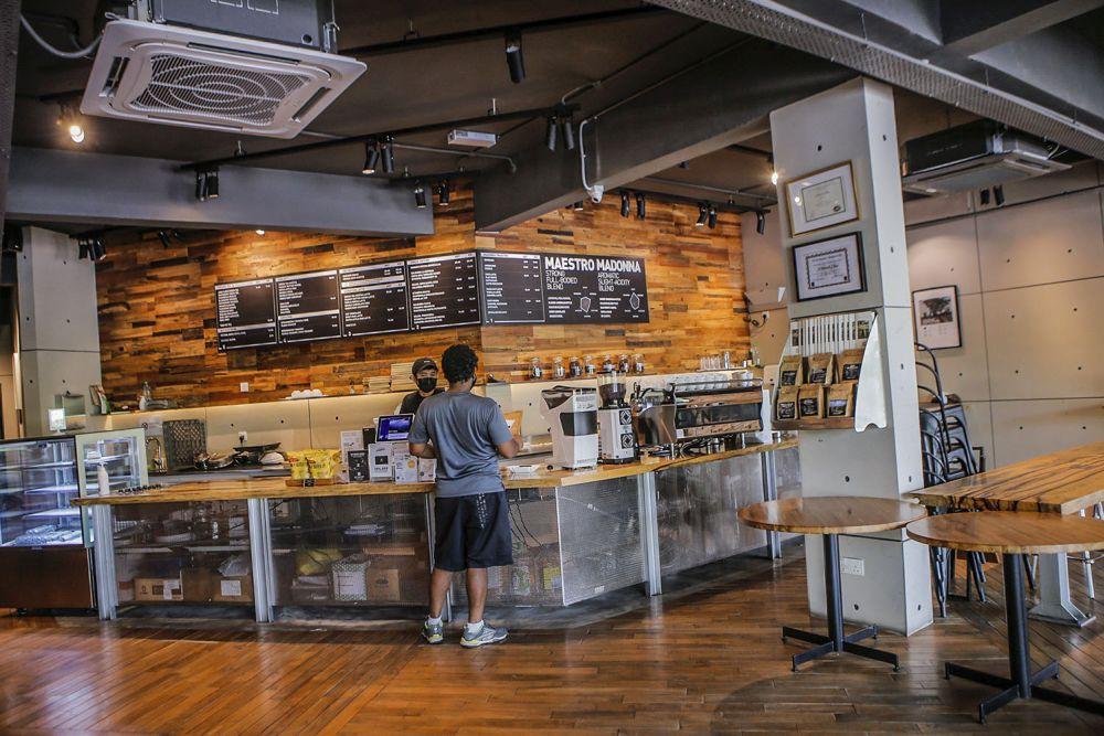 A patron orders a beverage at Coffea Coffee in Taman Danau Desa, Kuala Lumpur August 11, 2021.