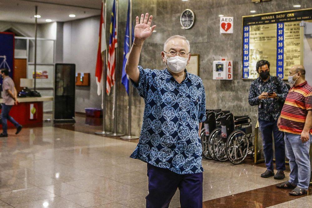 Datuk Seri Wee Ka Siong greets reporters at Umno's headquarters at Menara Dato Onn in Kuala Lumpur August 17, 2021. ― Picture by Hari Anggara