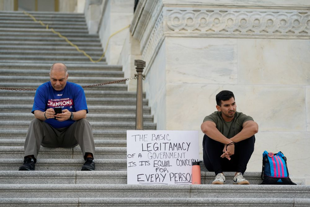 People gather on the House steps during a multi-day protest supporting an extension of the pandemic-related federal moratorium on residential evictions which has expired, outside the US Capitol in Washington August 1, 2021. — Reuters pic