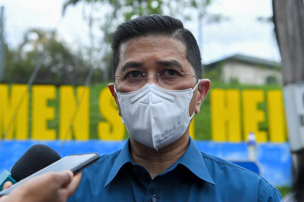 Datuk Seri Azmin Ali speaks to the media after visiting the site of the landslide at Kemensah Heights, September 18, 2021. — Bernama pic
