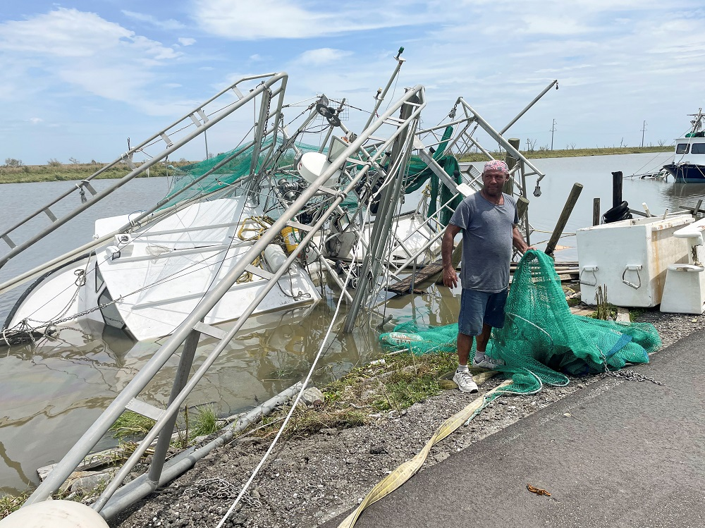 Shrimpers survey the damage to homes and shrimp boats after Hurricane Ida made landfall in Golden Meadow, Louisiana August 31, 2021. — Reuters pic