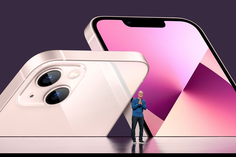 Apple CEO Tim Cook unveils the new iPhone 13 during a special event at Apple Park in Cupertino, California broadcast September 14, 2021. — Handout by Brooks Kraft/Apple Inc via Reuters