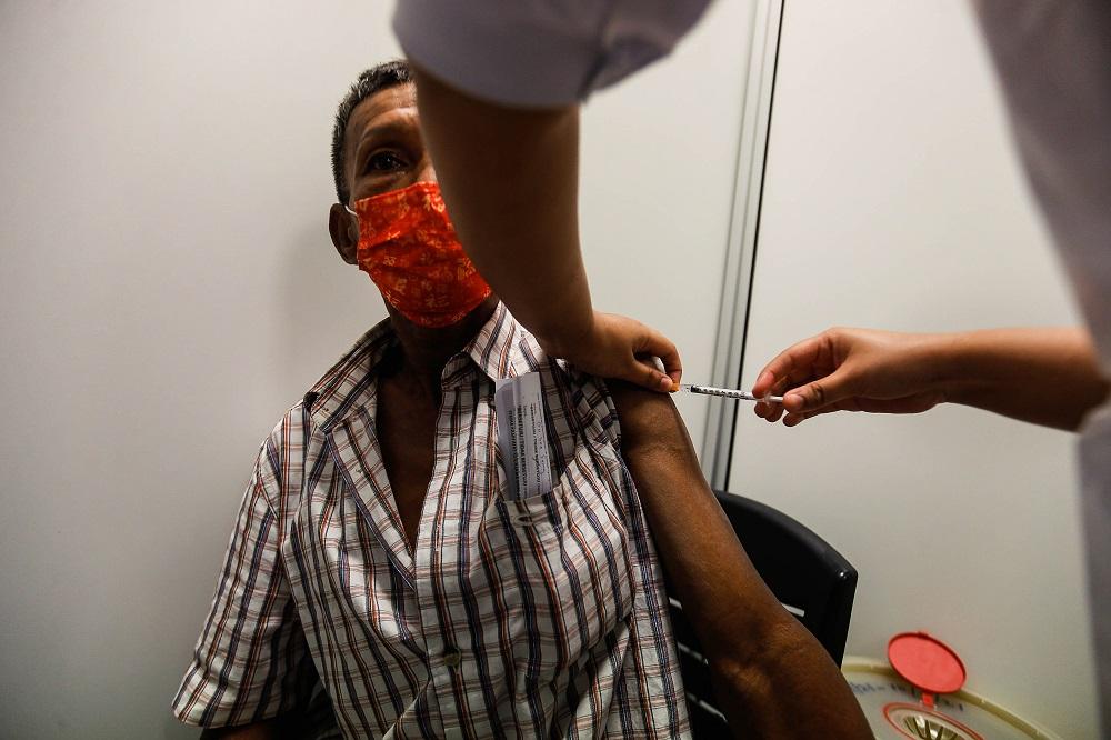 目前仍有26.4%人口仍未登记接种疫苗。-Sayuti Zainudin摄-