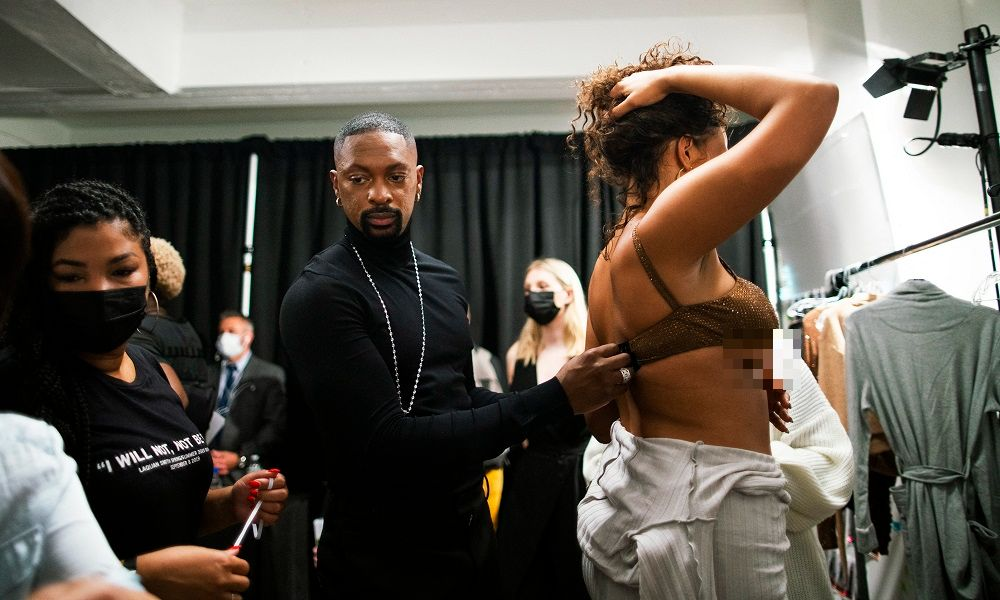 Designer LaQuan Smith works with a model before the presentation of his Spring 2022 Ready-To-Wear collection during New York Fashion Week. — AFP pic
