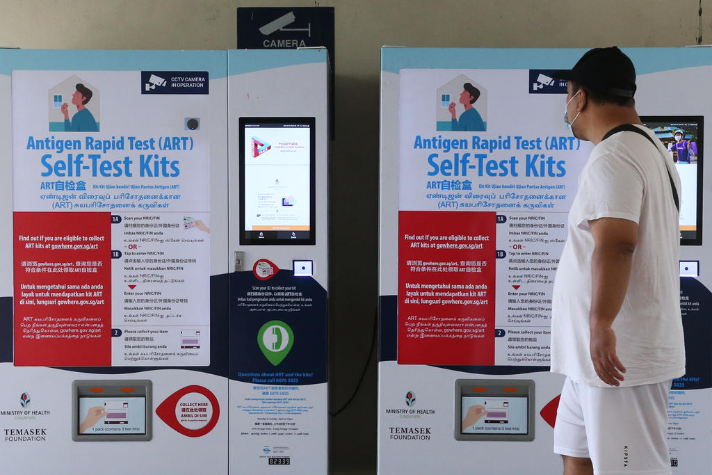 Two vending machines dispensing antigen rapid test kits at Blk 363 Woodlands Ave 5 on Sept 19, 2021. — TODAY pic