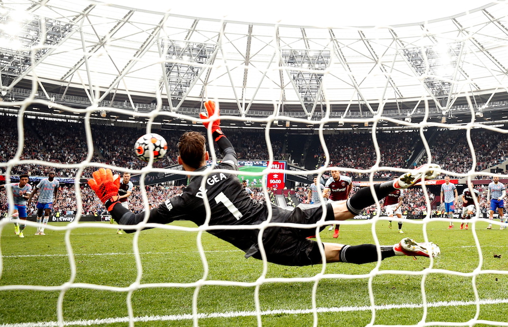 West Ham United's Mark Noble has his shot saved by Manchester United's David de Gea from the penalty spot at London Stadium, London, Britain  September 19, 2021. — Action Images via Reuters pic